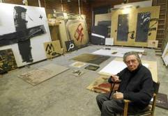 Antoni Tapies walking around his studio waiting for feeling like making the next move.